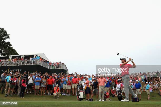 Webb Simpson of the United States plays his shot from the 18th tee during the final round of THE PLAYERS Championship on the Stadium Course at TPC...