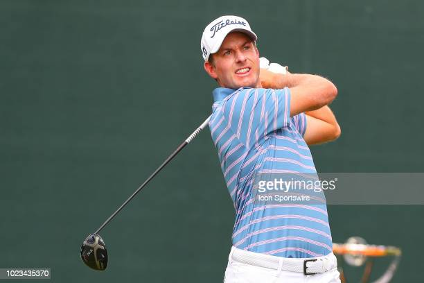 Webb Simpson of the United States plays his shot from the first tee during the third round of The Northern Trust on August 25 2018 at the Ridgewood...