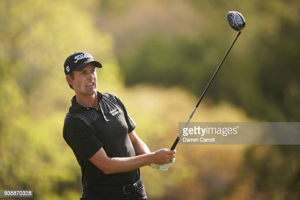 Webb Simpson of the United States plays his shot from the third tee during the first round of the World Golf ChampionshipsDell Match Play at Austin...