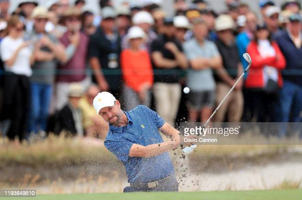 Webb Simpson of the United States plays his third shot on the 16th hole in his match with Patrick Reed against Marc Leishmanand Abraham Ancer of the...