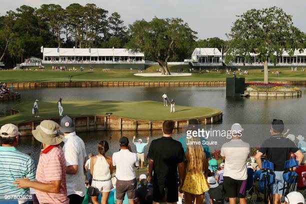 Webb Simpson of the United States putts for birdie on the 17th green during the third round of THE PLAYERS Championship on the Stadium Course at TPC...