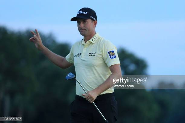 Webb Simpson of the United States reacts after finishing 22 under on the 18th green during the final round of the RBC Heritage on June 21, 2020 at...