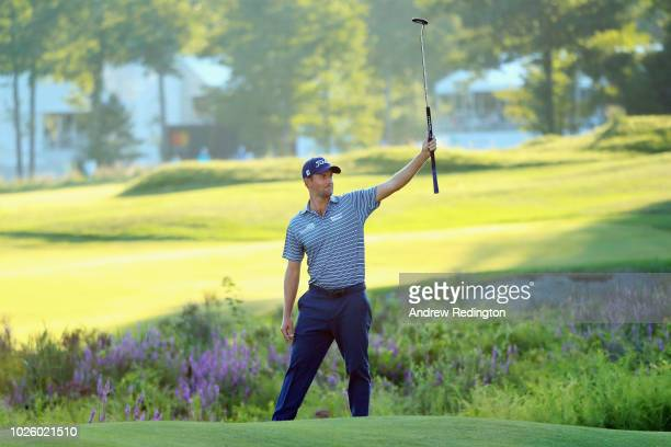 Webb Simpson of the United States reacts after making a putt for eagle on the 18th green during round two of the Dell Technologies Championship at...