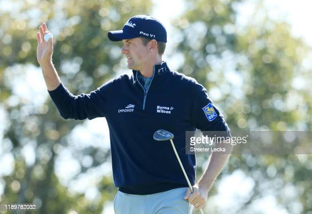 Webb Simpson of the United States reacts on the seventh green during the final round of the RSM Classic on the Seaside course at Sea Island Golf Club...