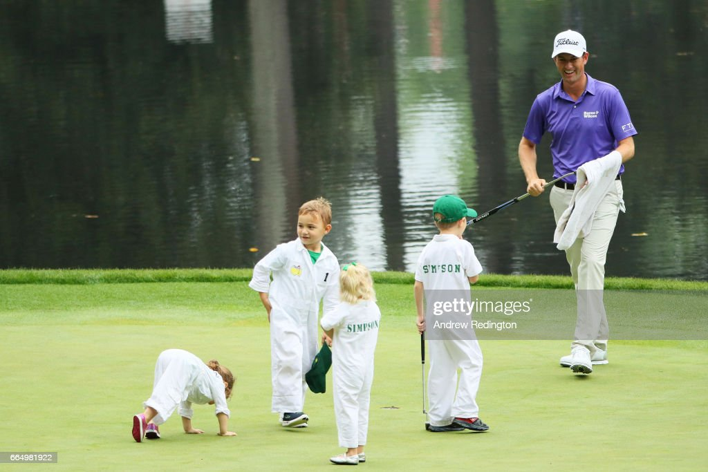 Webb Simpson of the United States smiles alongside his children and Bubba Watson's children during the Par 3 Contest prior to the start of the 2017 Masters Tournament at Augusta National Golf Club on April 5, 2017 in Augusta, Georgia.