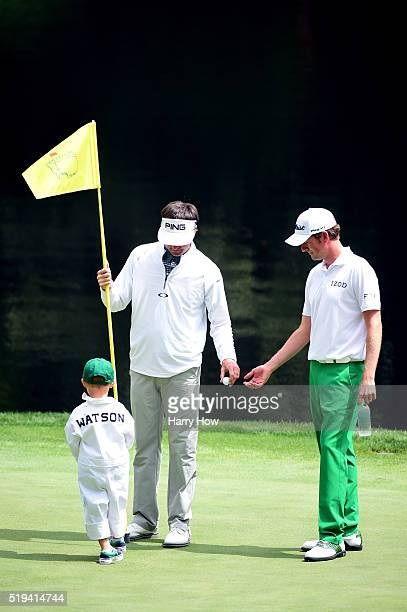 Webb Simpson of the United States talks to Bubba Watson of the United States and his son Caleb during the Par 3 Contest prior to the start of the of...