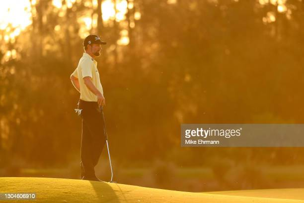 Webb Simpson of the United States waits on the 18th green during the final round of World Golf Championships-Workday Championship at The Concession...