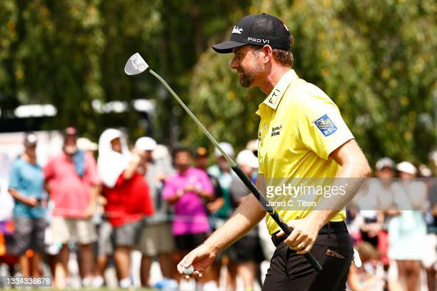 Webb Simpson of the United States walks onto the 18th green during the final round of the Wyndham Championship at Sedgefield Country Club on August...