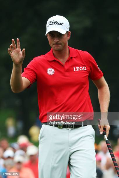 Webb Simpson of the United States waves to the gallery after making birdie on the sixth hole during the second round of the 95th PGA Championship on...