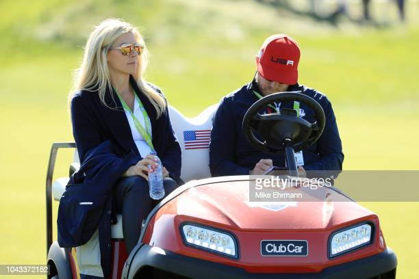 Webb Simpson of the United States wife Dowd Simpson and John Wood during singles matches of the 2018 Ryder Cup at Le Golf National on September 30...