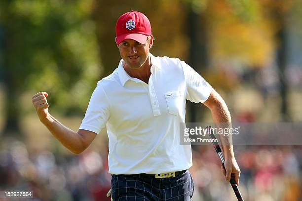 Webb Simpson of the USA celebrates a birdie putt on the 12th green during the Afternoon FourBall Matches for The 39th Ryder Cup at Medinah Country...