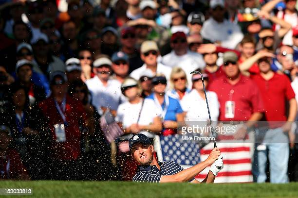 Webb Simpson of the USA plays a bunker shot during day two of the Morning Foursome Matches for The 39th Ryder Cup at Medinah Country Club on...