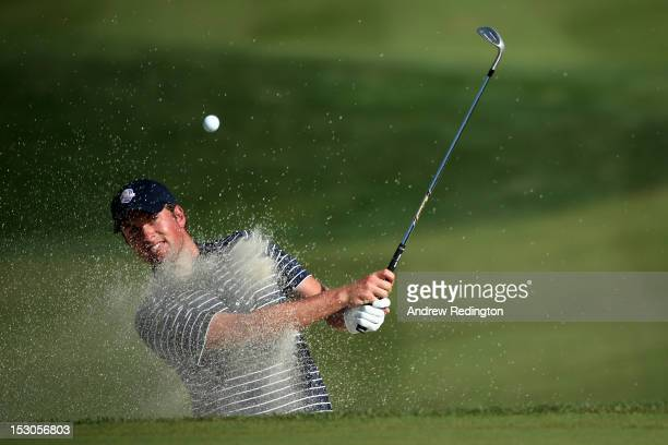Webb Simpson of the USA plays a bunker shot on the tenth hole during day two of the Afternoon FourBall Matches for The 39th Ryder Cup at Medinah...
