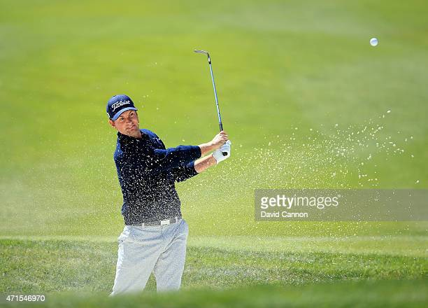 Webb Simpson of the USA plays his third shot at the par 5, fifth hole during round one of the World Golf Championship Cadillac Match Play at TPC...