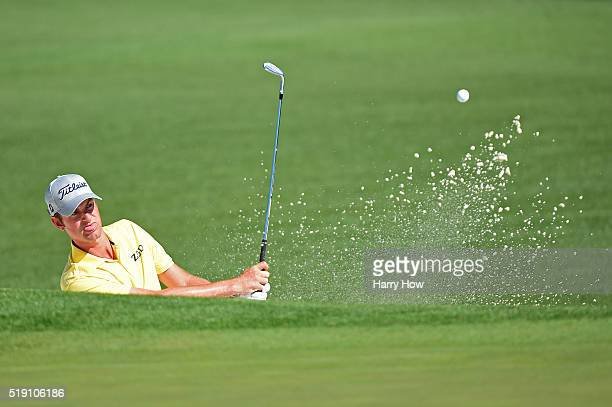 Webb Simpson plays a shot from a bunker on the second hole during a practice round prior to the start of the 2016 Masters Tournament at Augusta...