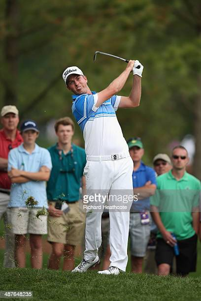 Webb Simpson plays from the rough on the 18th during the first round of the Wells Fargo Championship at the Quail Hollow Club on May 1 2014 in...