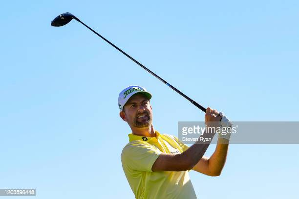 Webb Simpson plays his shot from the third tee during the final round of the Waste Management Phoenix Open at TPC Scottsdale on February 02 2020 in...