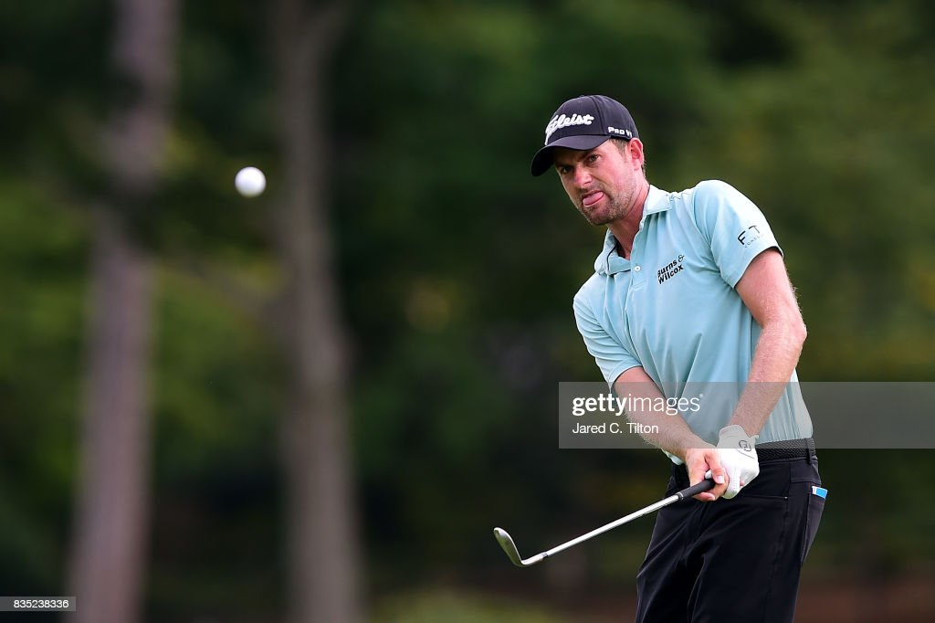 Webb Simpson plays his third shot on the ninth hole during the second round of the Wyndham Championship at Sedgefield Country Club on August 18, 2017 in Greensboro, North Carolina.