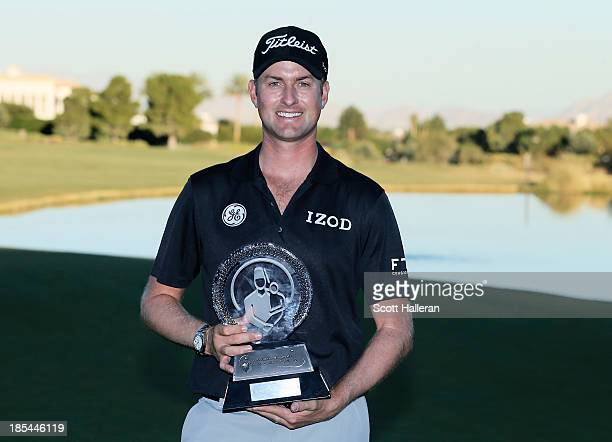 Webb Simpson poses with the trophy after his sixstroke victory during the final round of the Shriners Hospitals for Children Open at TPC Summerlin on...