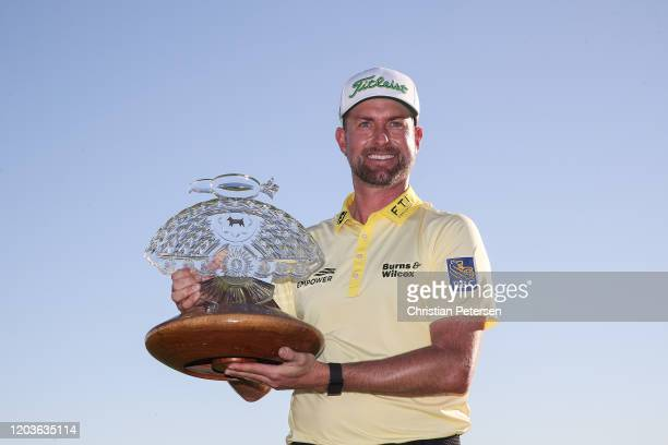 Webb Simpson poses with the winners trophy after winning the Waste Management Phoenix Open at TPC Scottsdale on February 02 2020 in Scottsdale Arizona
