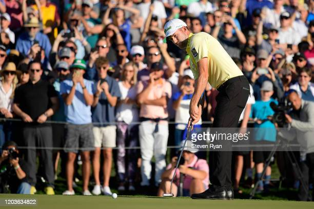 Webb Simpson putts for birdie on the first playoff hole during the final round to win Waste Management Phoenix Open at TPC Scottsdale on February 02,...