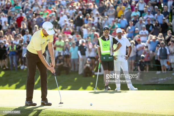 Webb Simpson putts for birdie on the first playoff hole to during the final round to win Waste Management Phoenix Open at TPC Scottsdale on February...