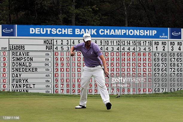 Webb Simpson reacts after he made a putt to force a playoff on the 18th hole during the final round of the Deutsche Bank Championship at TPC Boston...