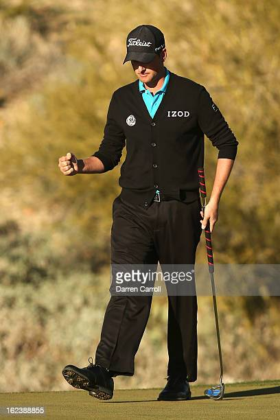 Webb Simpson reacts after he made his putt on the 18th hole green to win his match during the second round of the World Golf Championships Accenture...