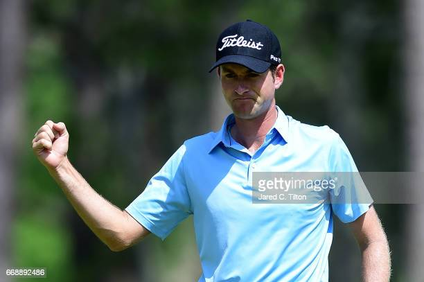 Webb Simpson reacts after making his par putt on the seventh green during the third round of the 2017 RBC Heritage at Harbour Town Golf Links on...
