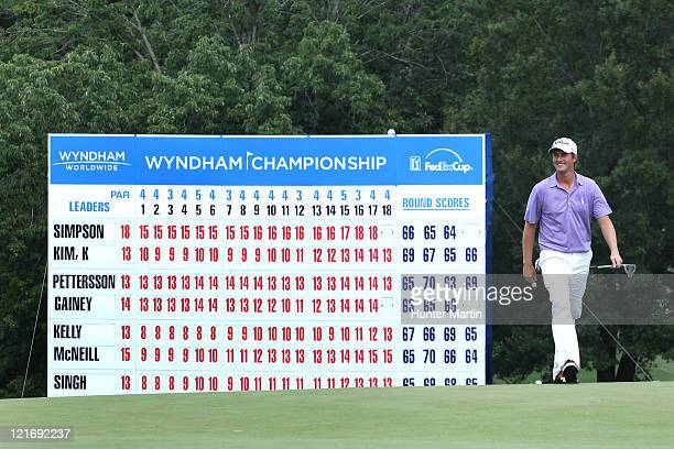 Webb Simpson smiles as he walks onto the 18th green during the final round of the Wyndham Championship at Sedgefield Country Club on August 21, 2011...