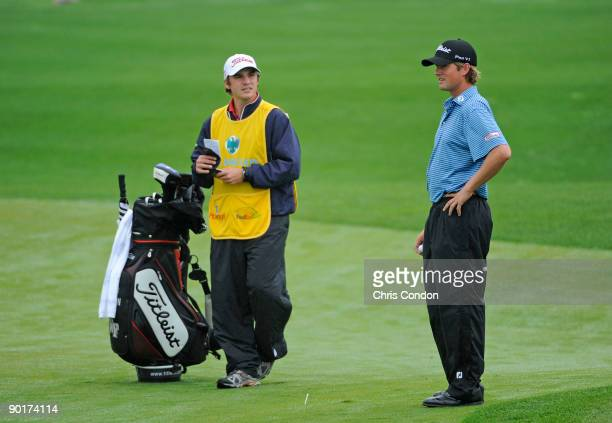Webb Simpson talks with his caddie on the first hole during the third round of The Barclays at Liberty National Golf Club on August 29, 2009 in...