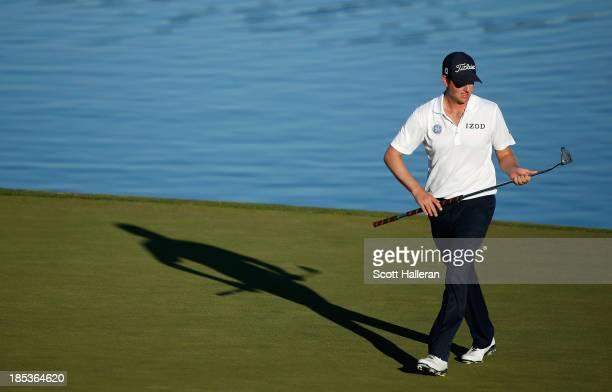 Webb Simpson walks across the 16th green during the third round of the Shriners Hospitals for Children Open at TPC Summerlin on October 19 2013 in...