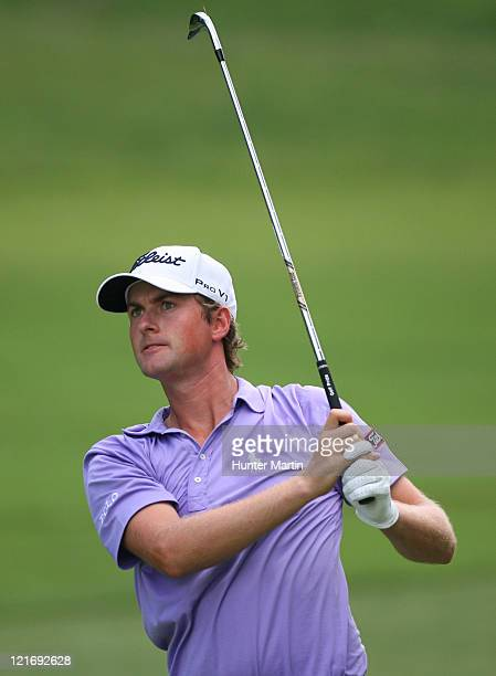 Webb Simpson watches his second shot on the 10th hole during the final round of the Wyndham Championship at Sedgefield Country Club on August 21,...