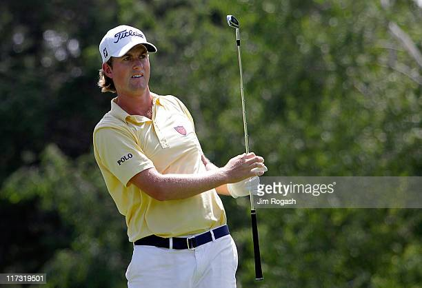 Webb Simpson watches his shot during round three of the Travelers Championship at TPC River Highlands on June 25 2011 in Cromwell Connecticut