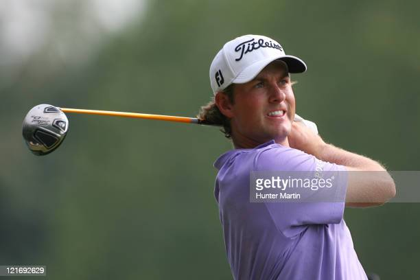 Webb Simpson watches his tee shot on the 13th hole during the final round of the Wyndham Championship at Sedgefield Country Club on August 21, 2011...