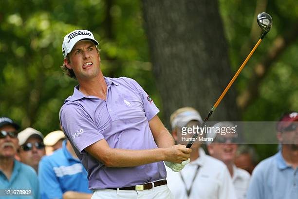 Webb Simpson watches his tee shot on the second hole during the final round of the Wyndham Championship at Sedgefield Country Club on August 21, 2011...