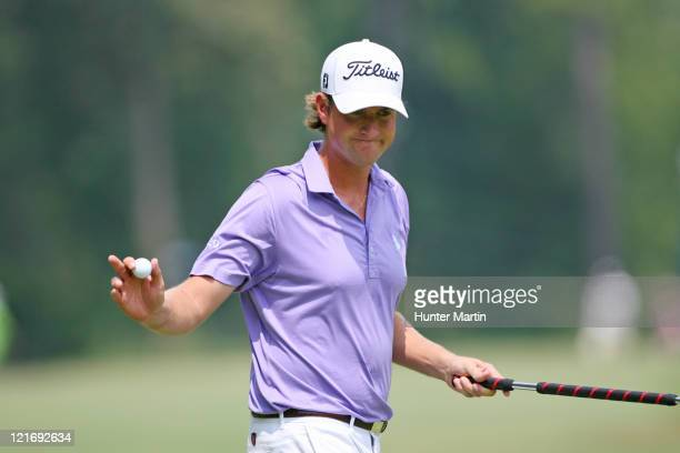 Webb Simpson waves to the crowd on the first hole during the final round of the Wyndham Championship at Sedgefield Country Club on August 21, 2011 in...
