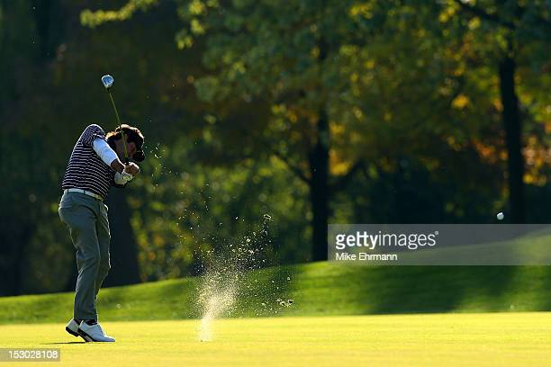 Webb Simpsonof the United States hits an approach shot on the 10th hole during day two of the Morning Foursome Matches for The 39th Ryder Cup at...