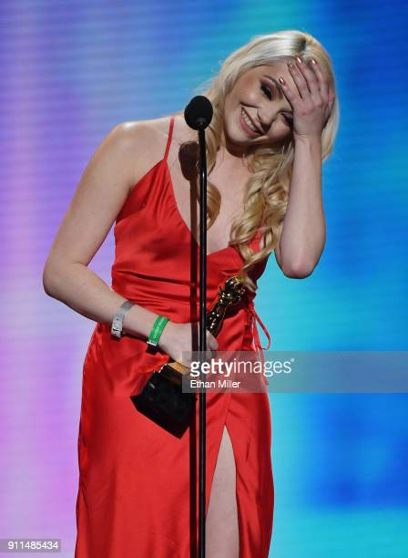 Webcam model Catjira reacts as she accepts the firstever award for Favorite Camming Cosplayer during the 2018 Adult Video News Awards at The Joint...