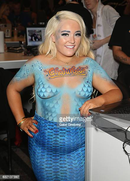 Webcam model Macy Kennedy dressed as a mermaid appears at the Chaturbate booth during the 2017 AVN Adult Entertainment Expo at the Hard Rock Hotel...