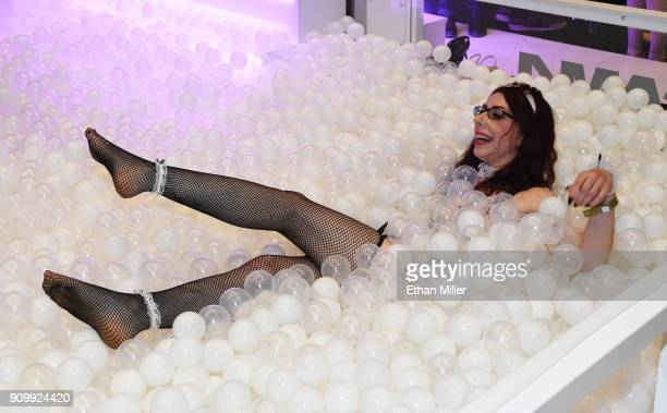 Webcam model Sammy Strips plays in a ball pit at the CAM4 booth at the 2018 AVN Adult Entertainment Expo at the Hard Rock Hotel Casino on January 24...