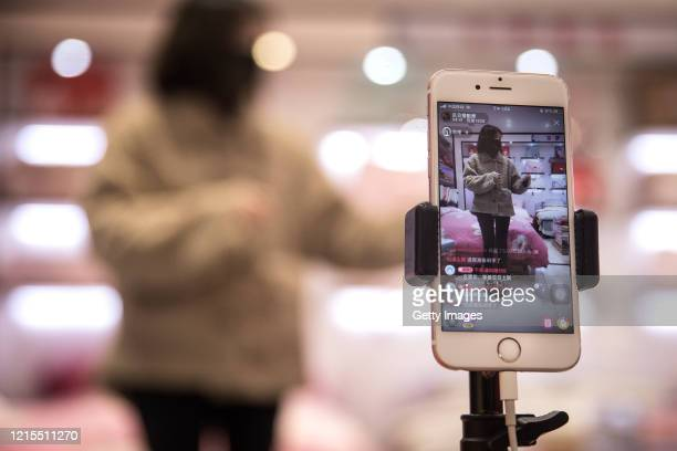 Webcasting Hostess presents goods via online live broadcast in Hankou north international commodity exchange center on March 29,2020 in Wuhan, Hubei...