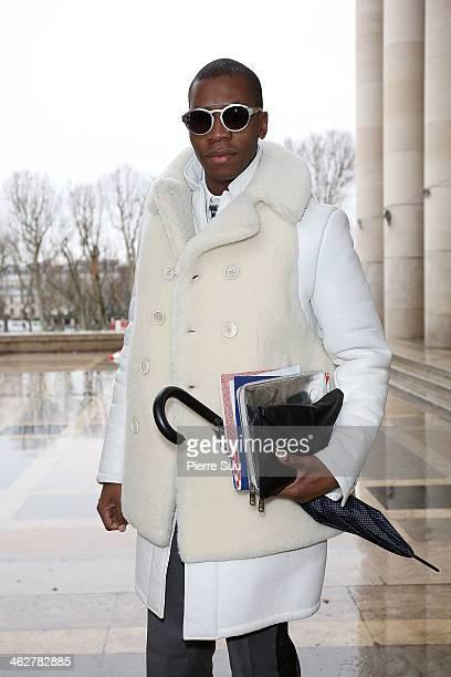 Webmaster Florian wears Givenchy CoatLanvin PantsBurberryArmani bagAlexander Mc Queen ipad sleeve on January 15 2014 in Paris France