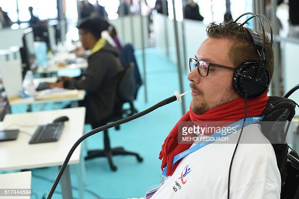A webmaster works with a humancomputer interface controlled by the lips during the 9th International Abylympics a skill competition featuring persons...