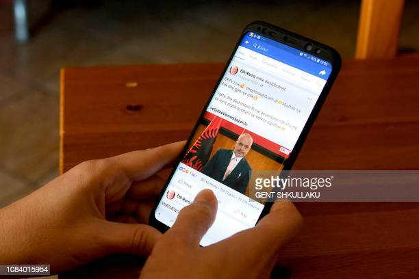Website with a meme of Albanian Prime Minister Edi Rama is seen on a smartphone in Tirana on January 17, 2019. - When it comes to quelling protests...