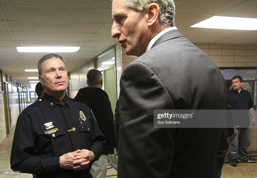 Webster Police Chief Gerald Pickering converses with New York State Lt. Gov. Robert Duffy, (R) following a news conference concerning the two firefighters killed, and two injured in a presumed ambush attack December 24, 2012 in Webster, New York. Authorities say an ex-con gunned down two firefighters after setting a car and a house on fire early Monday, then took shots at police and committed suicide while several homes burned.