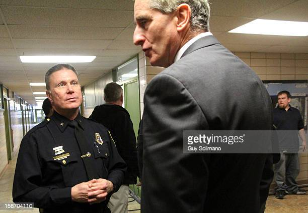 Webster Police Chief Gerald Pickering converses with New York State Lt Gov Robert Duffy following a news conference concerning the two firefighters...