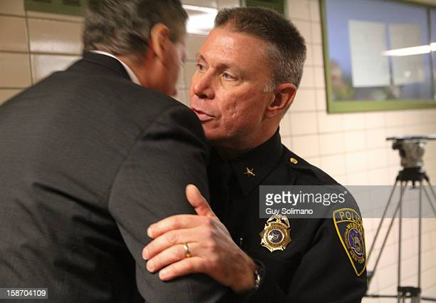 Webster Police Chief Gerald Pickering embraces New York State Lt Gov Robert Duffy following a news conference concerning the two firefighters killed...