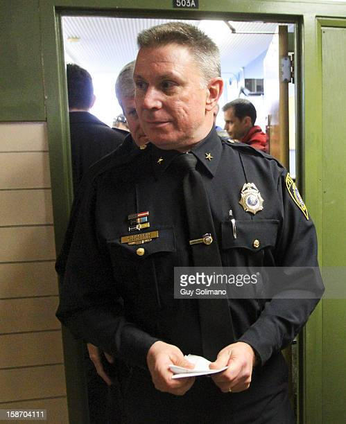Webster Police Chief Gerald Pickering exits a news conference concerning the two firefighters killed and two injured in a presumed ambush attack...