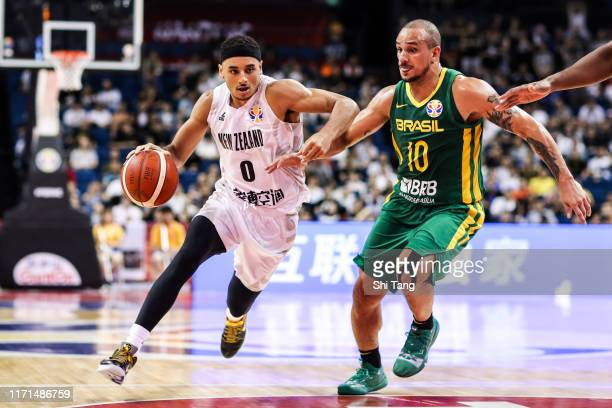 Webster Tai of New Zealand Team competes against the Garcia Alex of Brazil National Team during the 1st round of 2019 FIBA World Cup at Nanjing Youth...